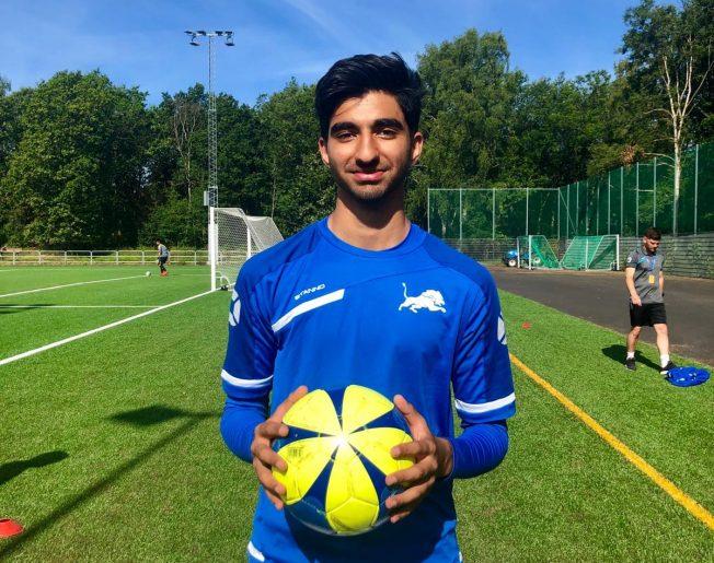 teenage boy holding a football